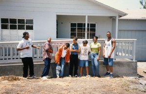 class of 00 in front of house